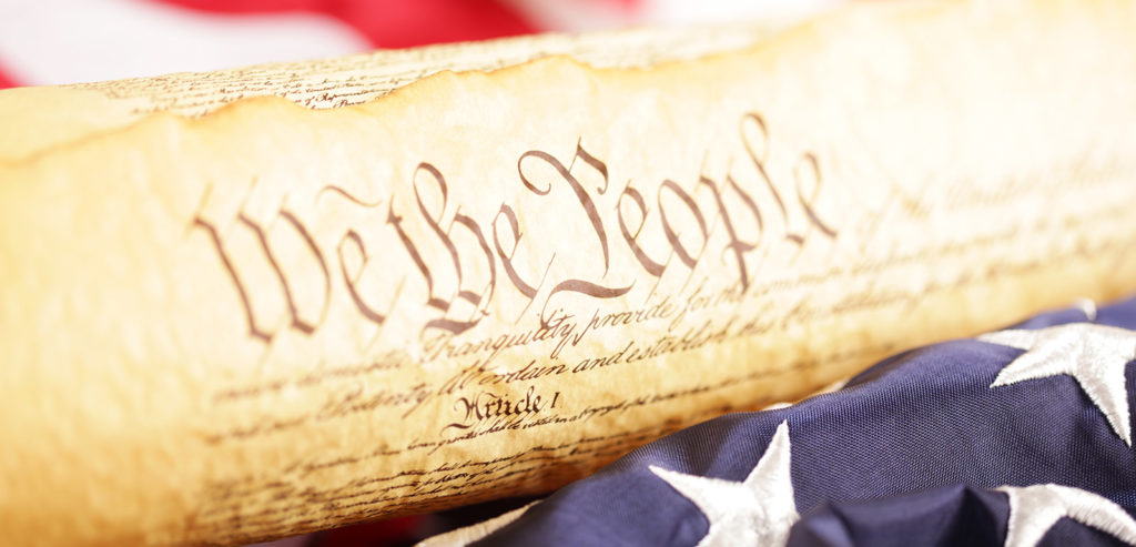 United States Constitution concept with a flag and legal scale